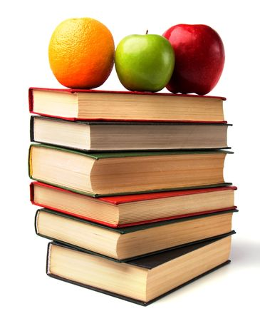 book stack with fruits isolated on white background