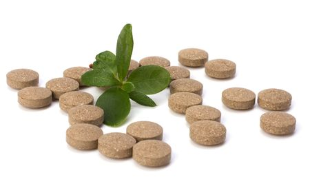 herbal pills isolated on white background photo