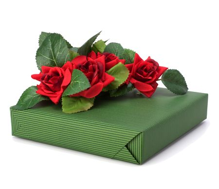 Gift with floral decor. Flowers are artificial. Stock Photo - 6341665