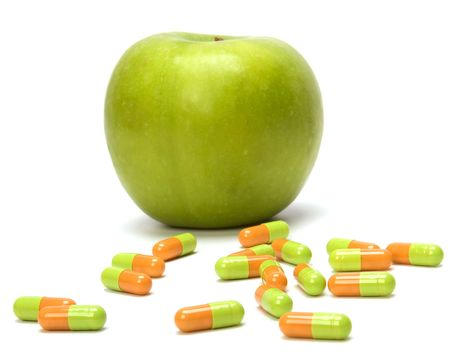 apple and pills isolated on white background photo