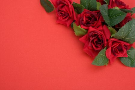 Red background with floral decor. Flowers are artificial. photo
