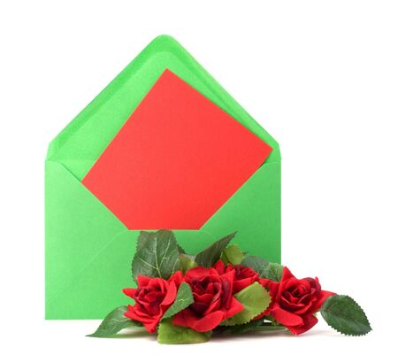 Envelope with floral decor. Flowers are artificial. photo