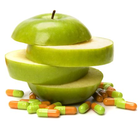 sliced apple: sliced apple and pills isolated on white background Stock Photo
