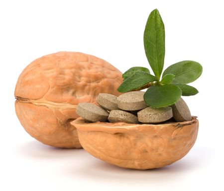 Walnut: herbal pills isolated on white background Kho ảnh