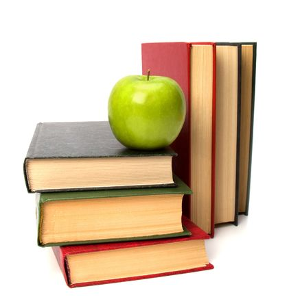 book stack with apple isolated on white background photo
