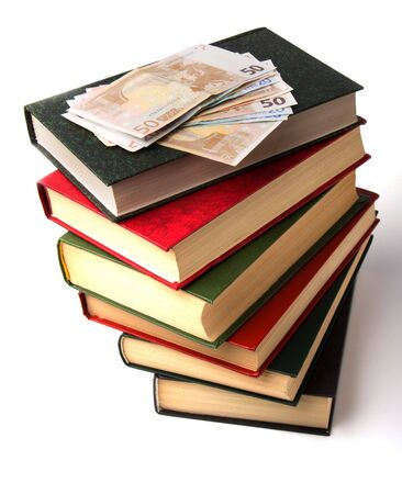 Money over book stack.  Education  concept photo