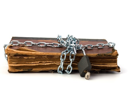 tattered book with chain and padlock isolated on white background Stock Photo - 7154938