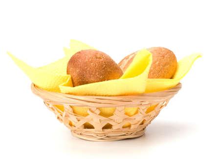 breadbasket: fresh warm rolls in breadbasket isolated on white background Stock Photo