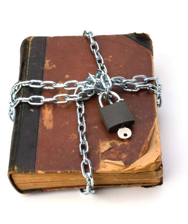 tattered book with chain and padlock isolated on white background photo