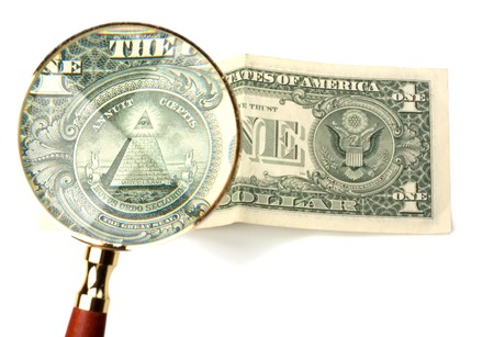 hand magnifier over banknote isolated on white background photo