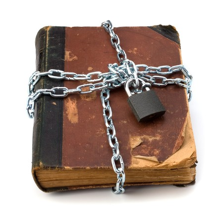 tattered book with chain and padlock isolated on white background Stock Photo - 7497778
