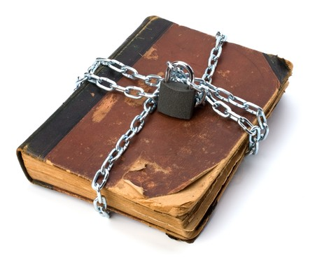 tattered book with chain and padlock isolated on white background Stock Photo - 7497806