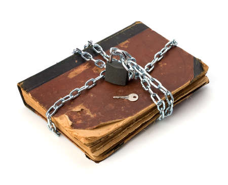 tattered book with chain and padlock isolated on white background Stock Photo - 8285065
