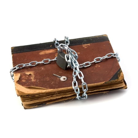 tattered book with chain and padlock isolated on white background Stock Photo - 8284426