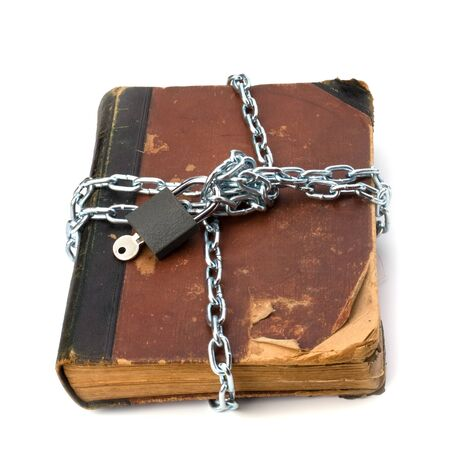 tattered book with chain and padlock isolated on white background Stock Photo - 8285050