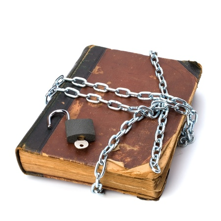 tattered book with chain and padlock isolated on white background Stock Photo - 8285540