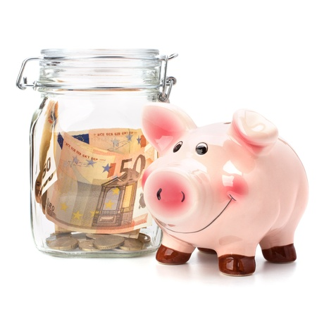 Business concept. Money savings in glass pot. photo