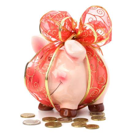 Christmas deposit concept. Piggy bank with festive bow isolated on white. Stock Photo - 8283780
