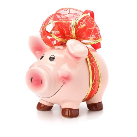 Christmas deposit concept. Piggy bank with festive bow isolated on white. Stock Photo - 8281747