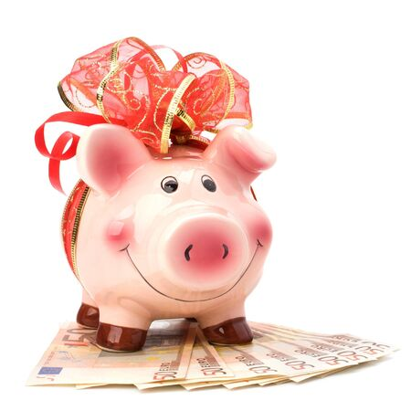 Christmas deposit concept. Piggy bank with festive bow isolated on white. Stock Photo - 8282044