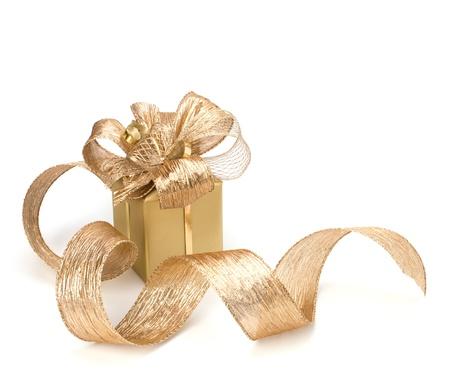 golden ribbon: Luxurious gift isolated on white background Stock Photo