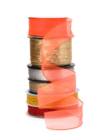 Festive ribbons stack isolated on white background photo