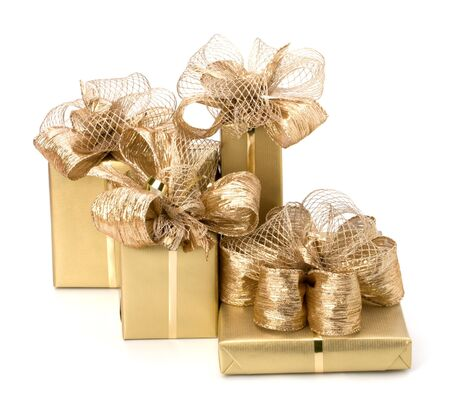 Gold gifts isolated on white background photo