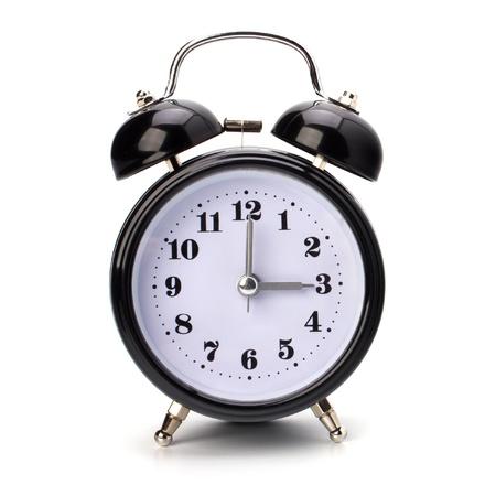 Black alarm clock isolated on white background photo