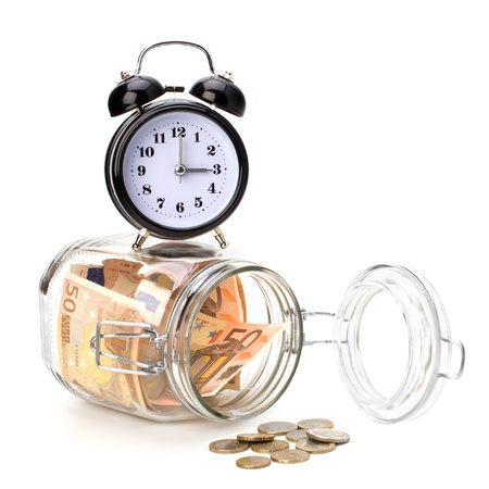Money accumulation concept. Money and alarm clock isolated on white background. Stock Photo - 8281745