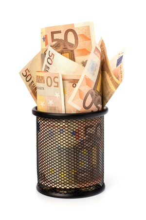 destitution: Waste of money concept. Euro currency in garbage bin isolated on white background.