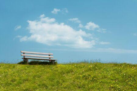 Bench on sky background. Tranquil scene. photo