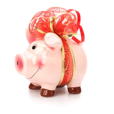 Christmas deposit concept. Piggy bank with festive bow isolated on white. Stock Photo - 8390061