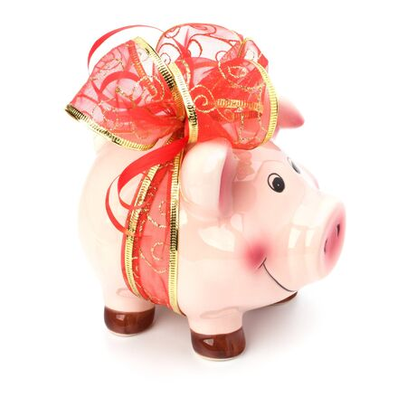 Christmas deposit concept. Piggy bank with festive bow isolated on white. photo