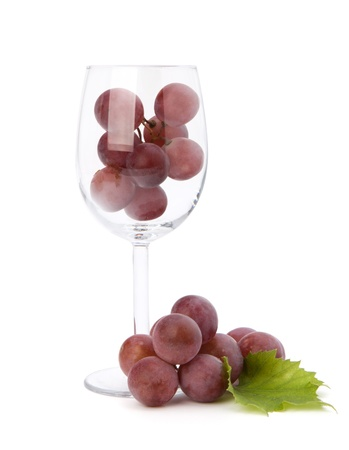 wine glass full with grapes  isolated on white background photo