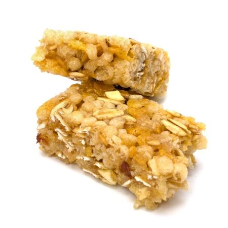 barra de cereal: Aderezos saludables aislados en fondo blanco