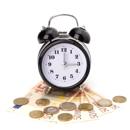 Money accumulation concept. Money and alarm clock isolated on white background. Stock Photo - 8527030