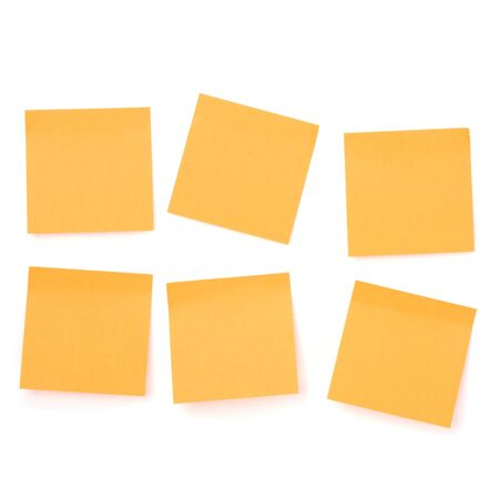 Yellow sticky memo paper isolated on white background photo