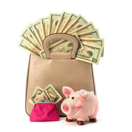 Shopping concept. Handbag full with money isolated on white background. photo