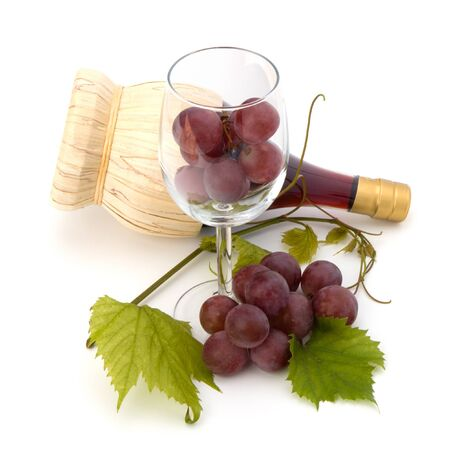 red wine bottle and glass full with grapes  isolated on white background photo