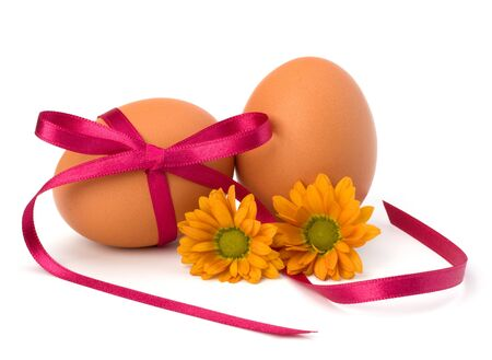 Easter egg with festive bow isolated on white background photo