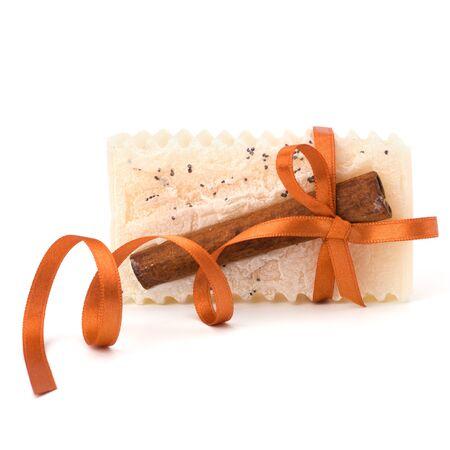 Luxurious handmade cinnamon soap isolated on white background photo
