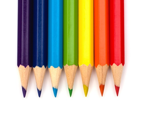 Colour pencils isolated on white  background close up photo