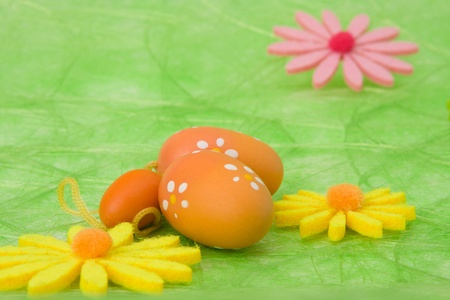Easter background. Easter eggs and flowers on green sisal background, selective DOF. photo