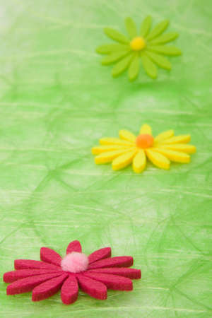 Spring background. Flowers on green sisal background, selective DOF. photo