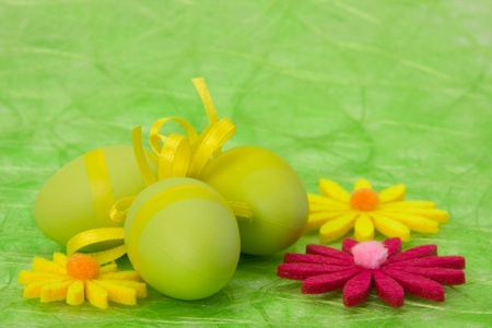 Easter background. Easter eggs and flowers on green sisal background, selective DOF. Stock Photo - 9053699