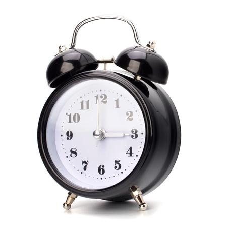 deadline: Black alarm clock isolated on white background Stock Photo