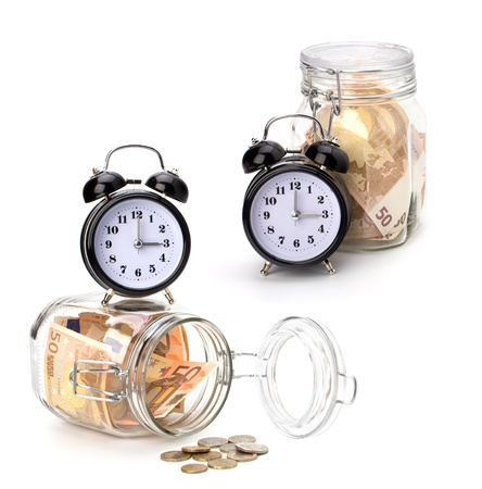 Money accumulation concept. Money and alarm clock isolated on white background. photo