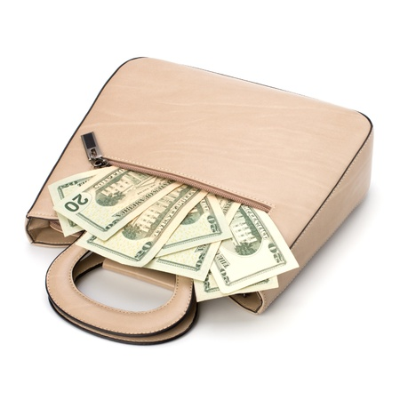 Glamour handbag full with money isolated on white background photo