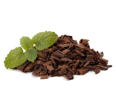 Crushed chocolate shavings pile and mint leaf isolated on white background Stock Photo - 9477146