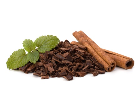 Crushed chocolate shavings pile and cinnamon sticks isolated on white background Stock Photo - 9477114